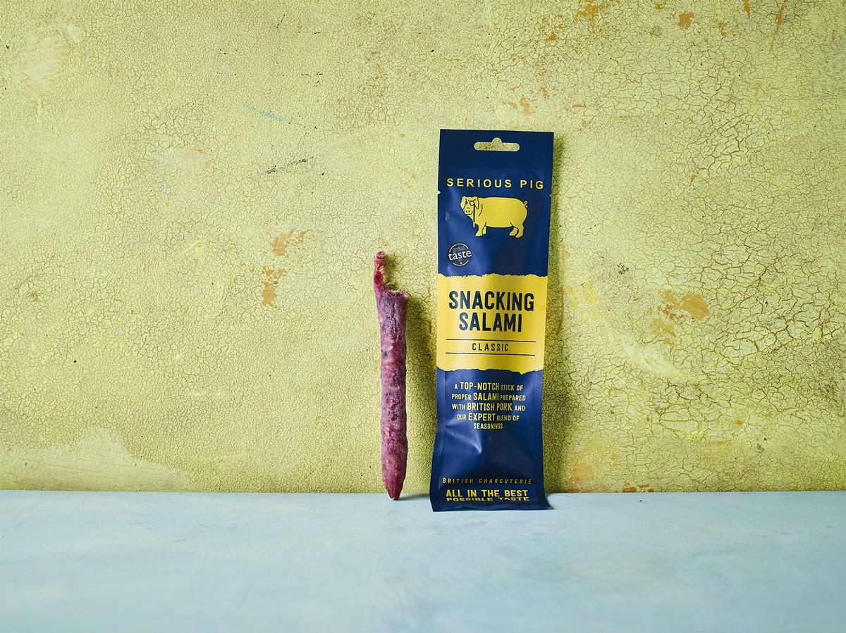 serious pig snacking salami